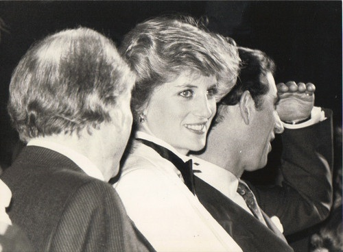29 FEBRUARY 1984 (LEAP YEAR) PRINCE CHARLES & PRINCESS DIANA ATTEND A GENESIS CONCERT IN BIRMINGHAM; SHE WEARS TUXEDO BY MARGARET HOWELL