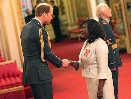 Receiving an MBE from Prince William