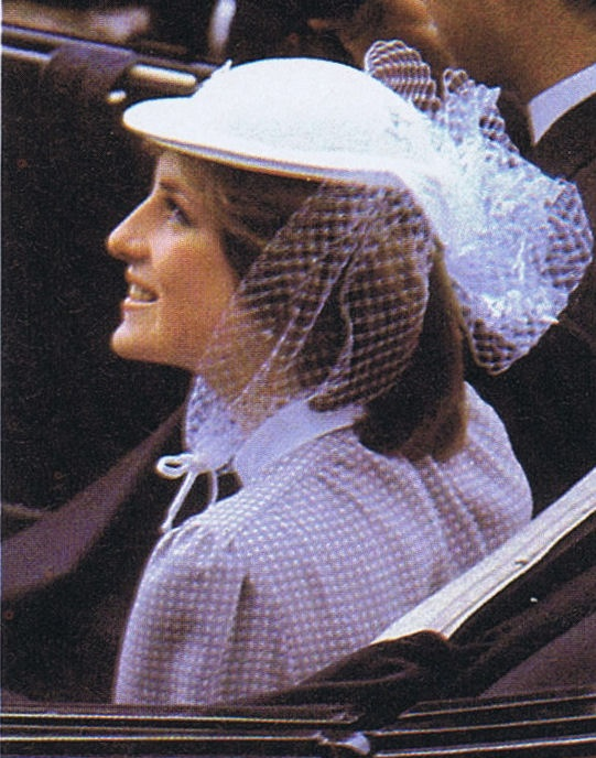 Her John Boyd hat had tiny bows attached to the netting