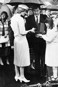 The Princess of Wales receiving a sculptured rose from Ravenswood resident Sarah Turner and former chairman Ronnie Gottlieb.