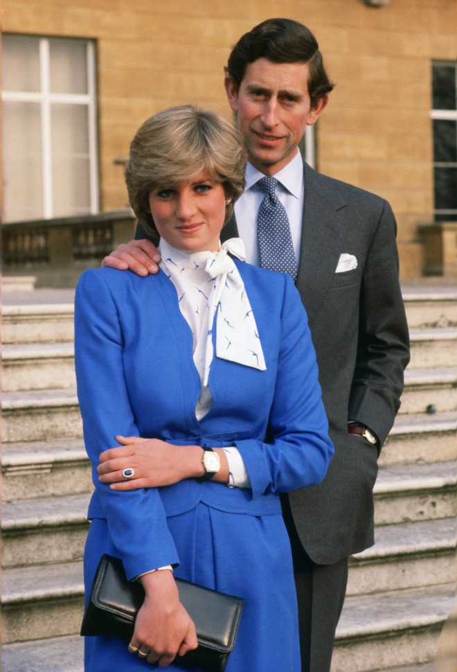 GREAT BRITAIN - FEBRUARY 24: Lady Diana Spencer (later to become Princess of Wales) reveals her sapphire and diamond engagement ring while she and Prince Charles, Prince of Wales pose for photographs in the grounds of Buckingham Palace following the announcement of their engagement (Photo by Tim Graham/Getty Images)